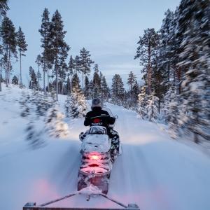 Reindeer herder on his snowmobile