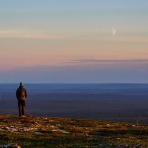 Self portrait watching the moon from the top of the Kiilopää fell in Lapland