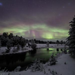 Aurora reflecting on Open Water near Inari in Finnish Lapland