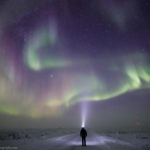Rayann Elzein watching the Northern Lights in Inari