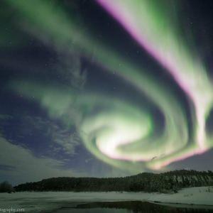 Strong Aurora above Open Water near Inari