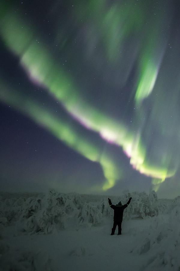 Photographer Rayann Elzein enjoying a powerful Northern Lights display