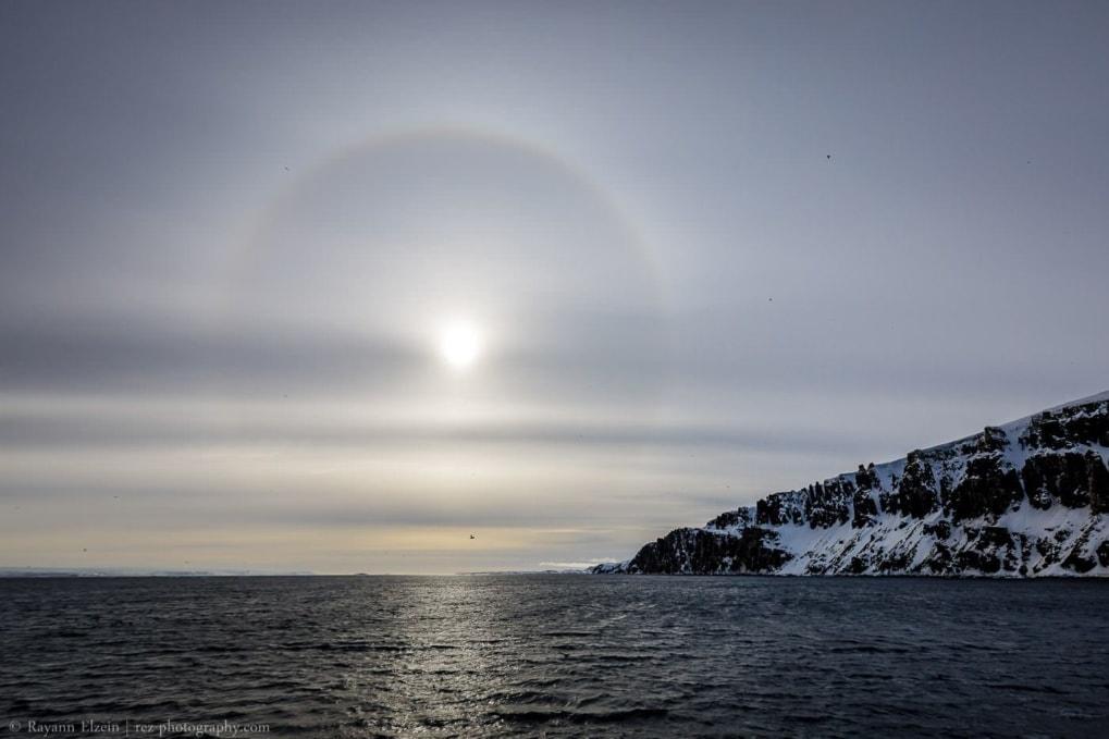 A 22° sun halo above the Alkefjellet bird cliff