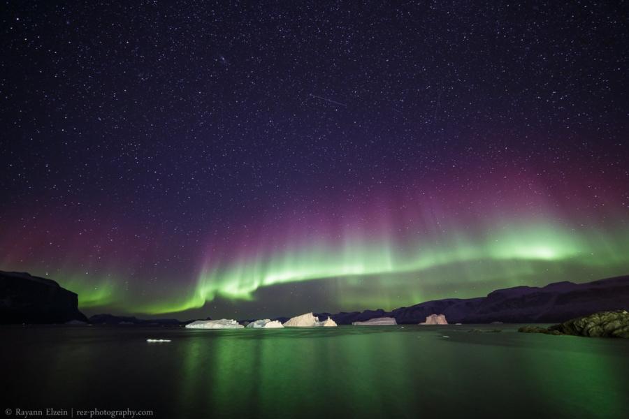 Aurora above floating icebergs in Uummannaq, Greenland.
